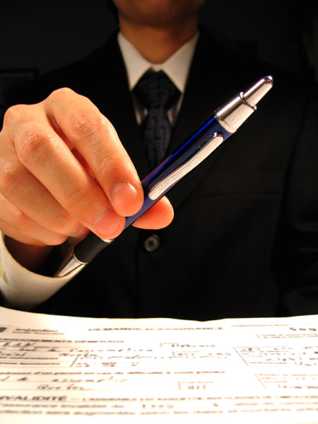 Man with contract and pen on sale of business escrow services
